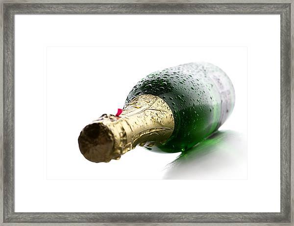 Wet Champagne Bottle Framed Print