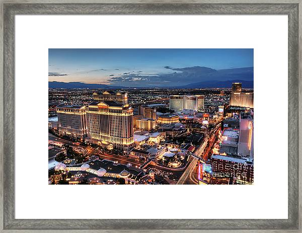 When Vegas Comes To Life Framed Print by Eddie Yerkish