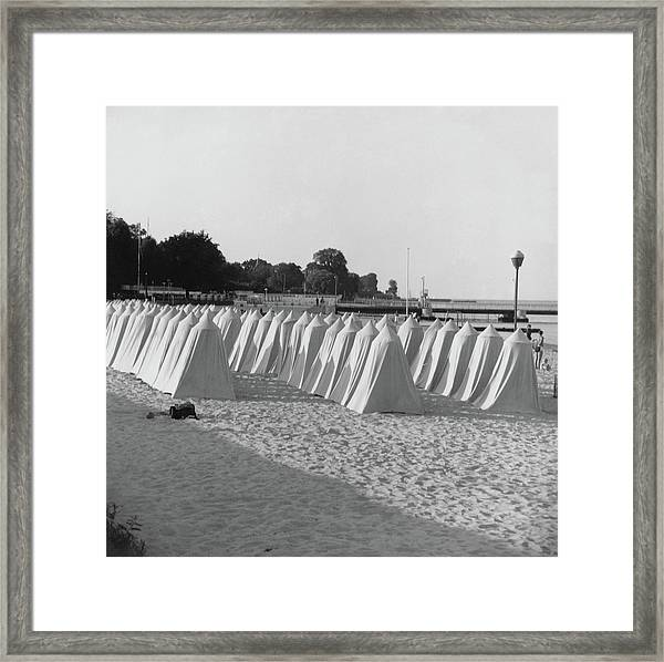 White Tents On A Beach Framed Print