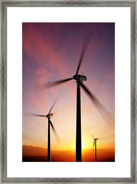 Wind Turbine Blades Spinning At Sunset Framed Print