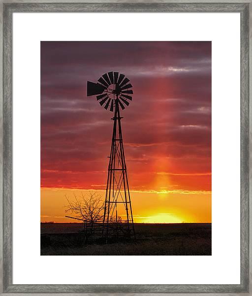 Windmill And Light Pillar Framed Print