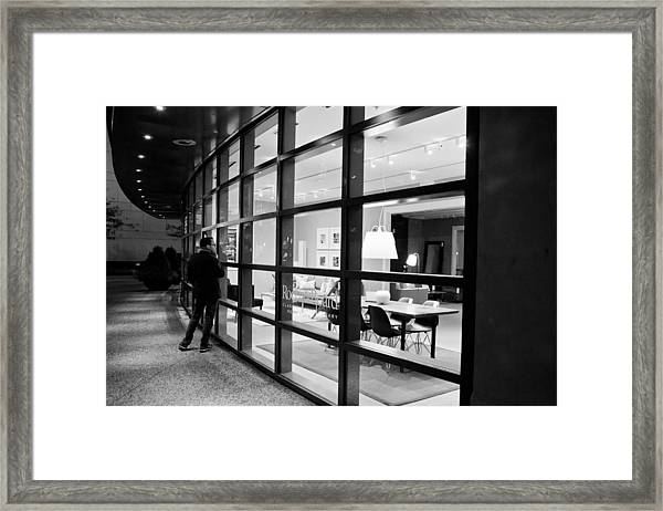 Window Shopping In The Dark Framed Print