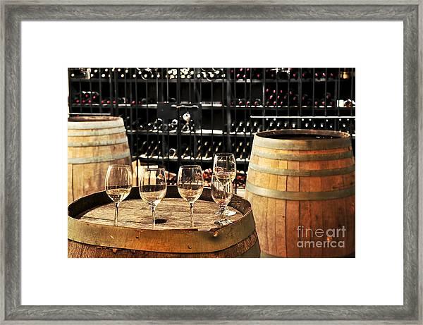 Wine Glasses And Barrels Framed Print