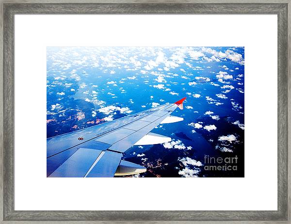 Wings And Clouds Framed Print