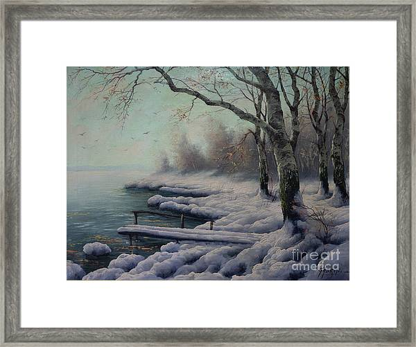 Winter Coming On The Riverside Framed Print