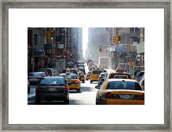 Winter Sun Illuminates Downtown Framed Print