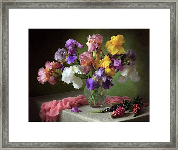With A Bouquet Of Irises And Flowers Lupine Framed Print