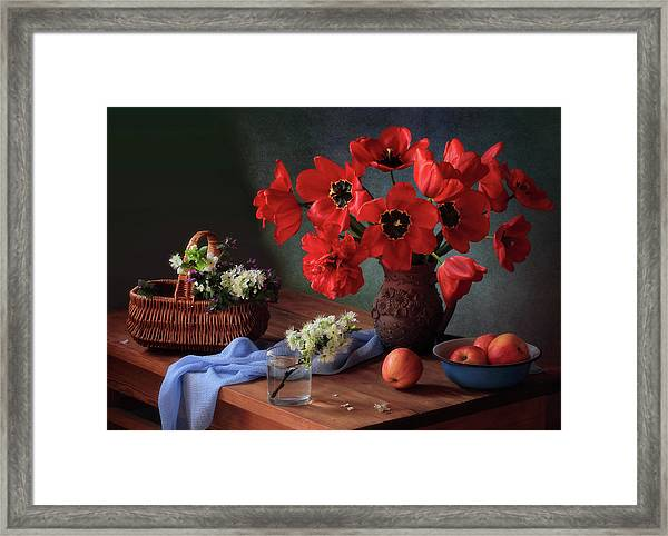 With A Bouquet Of Red Tulips Framed Print
