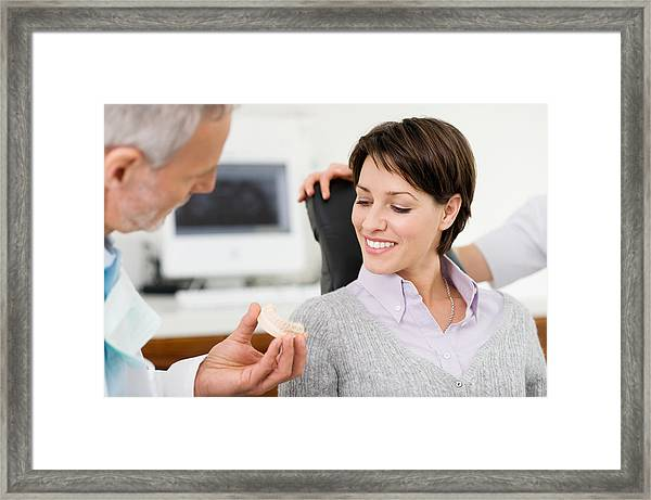 Woman And Dentist Framed Print by Image Source