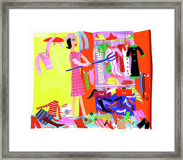 Woman Clearing Out Clothes From Messy Framed Print