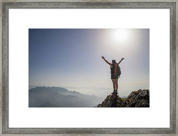 Woman Exulting On A Mountaintop Framed Print
