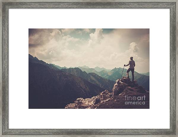 Woman Hiker On A Top Of A Mountain Framed Print