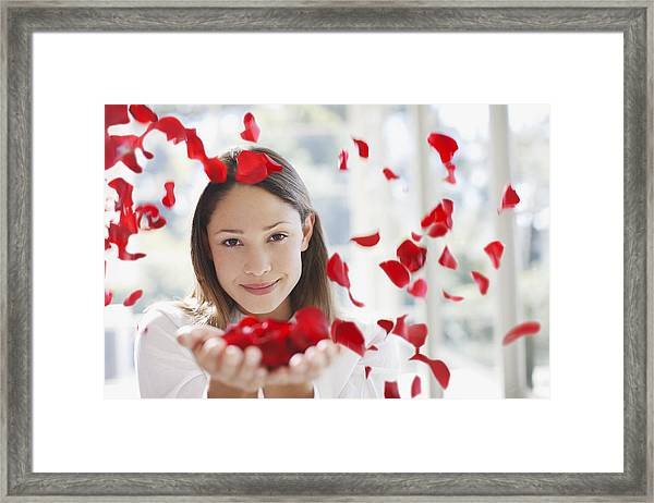Woman Holding Handful Of Flower Petals Framed Print by Tom Merton