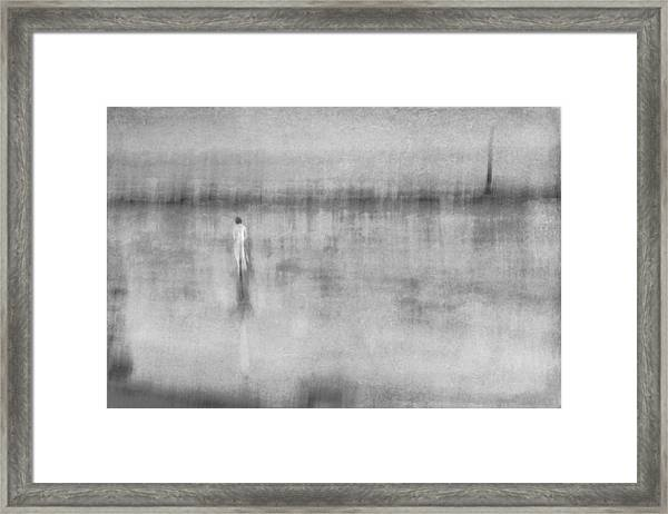 Woman In White At The Beach Framed Print