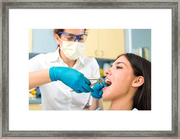 Woman Is Having Her Tooth Pulled Out. Framed Print by Bluecinema