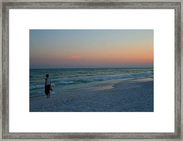 Woman On Beach At Dusk Framed Print
