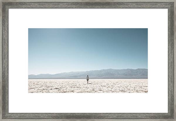Woman On Field Against Clear Sky Framed Print by Christian Soldatke / EyeEm