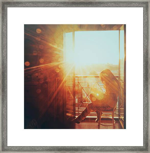 Woman Reading In The Morning Sun Framed Print by Julia Davila-Lampe