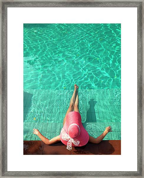 Woman Resting At Edge Of Swimming Pool Framed Print