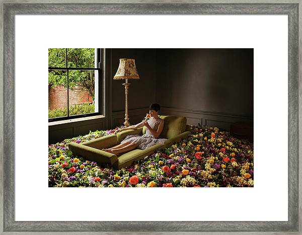 Woman Sitting On Sofa Surrounded By Framed Print by Anthony Harvie