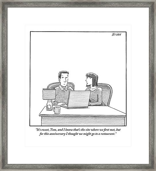 Woman Speaks To Husband As They Sit Behind A Desk Framed Print