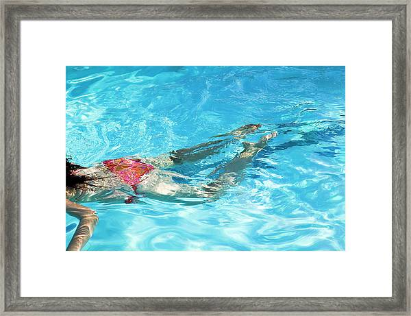 Woman Swimming Framed Print by Gustoimages/science Photo Library