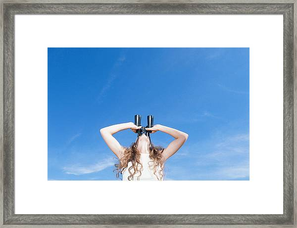 Woman Using Binocular, Looking Up, Low Angle View Framed Print by David De Lossy