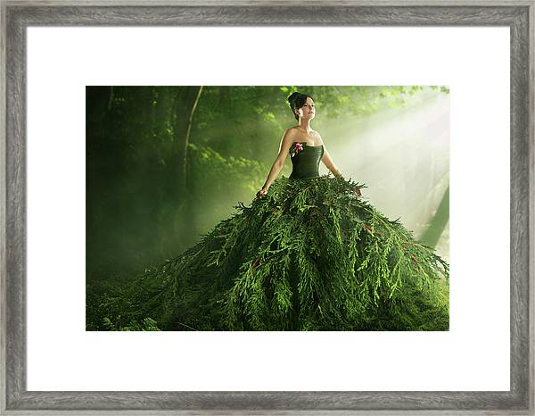 Woman Wearing A Large Green Gown In The Framed Print