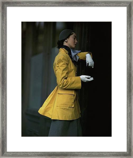 Woman Wearing A Yellow Coat Framed Print