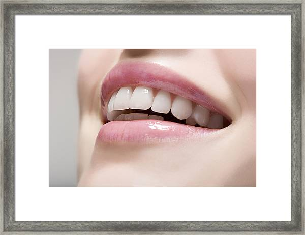 Woman Wearing Lip Gloss Framed Print by Image Source