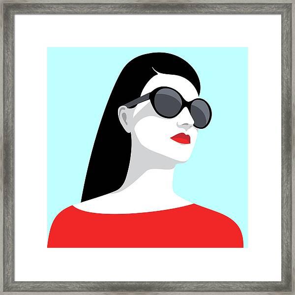 Woman Wearing Sunglasses Framed Print