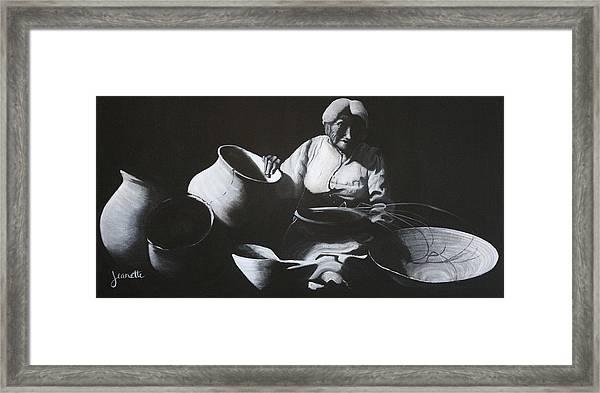 Woman Weaving A Basket Framed Print