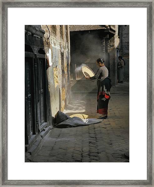 Woman Winnowing Framed Print by Richard Berry