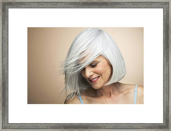 Woman With A Silvery,grey Bob Looking Down. Framed Print by Andreas Kuehn
