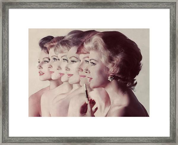 Women Wearing Revlon Lipstick Framed Print