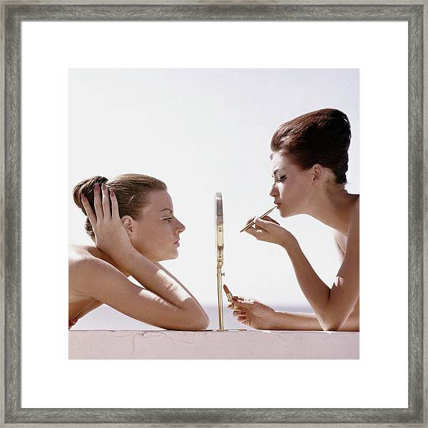 Women With A Mirror Framed Print