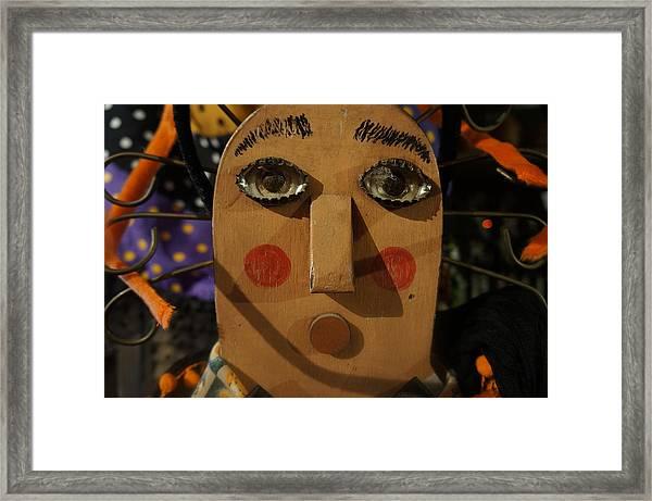 Wooden Face Framed Print