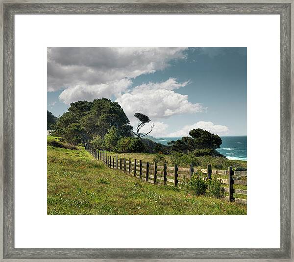 Wooden Fence Along California Coast Framed Print by Ed Freeman