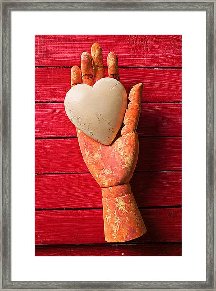 Wooden Hand With White Heart Framed Print