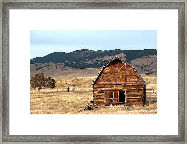 Wooden Hut In The Countryside Of Framed Print