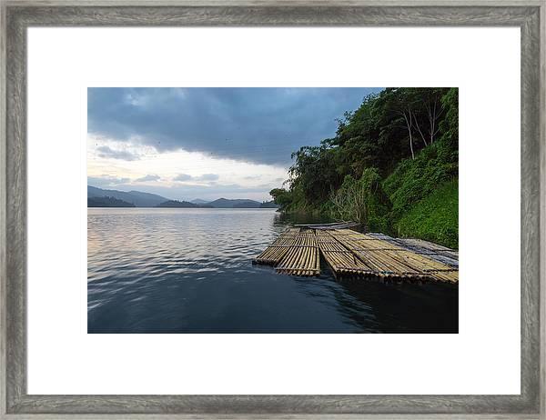 Wooden Rafts Moored On Lake By Trees Against Cloudy Sky Framed Print by Shaifulzamri Masri / EyeEm