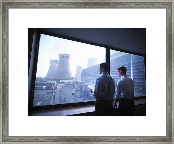 Workers Looking Out Over Power Station Framed Print by Monty Rakusen