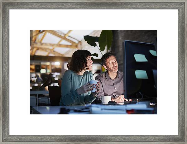 Working Late In A Small Office In Barcelona Framed Print by Tempura
