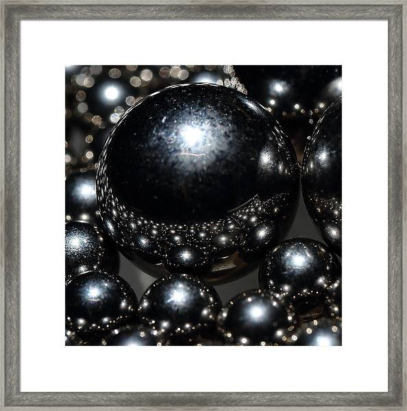 Worlds Framed Print