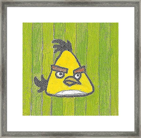 Yellow Angry Bird Framed Print by Fred Hanna