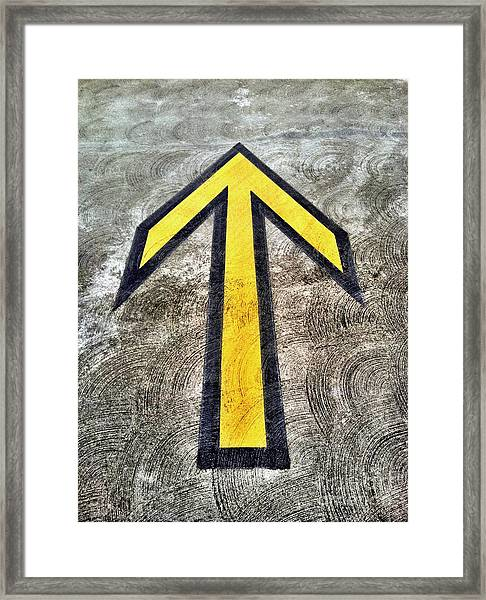 Yellow Directional Arrow On Pavement Framed Print