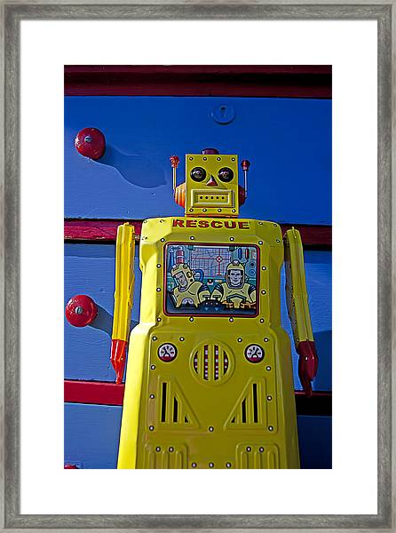 Yellow Robot In Front Of Drawers Framed Print