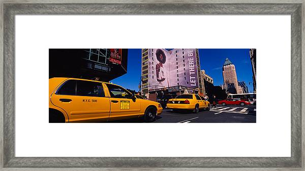 Yellow Taxies At The Road Intersection Framed Print