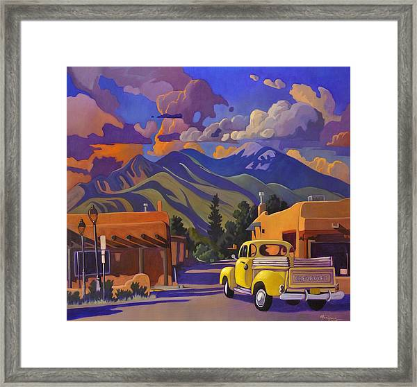 A Yellow Truck In Taos Framed Print