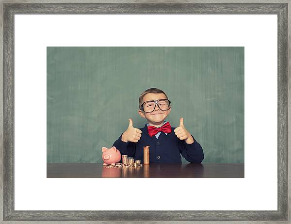 Young Boy Nerd Saves Money In His Piggy Bank Framed Print by RichVintage
